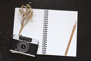 blank notebook and film camera