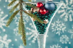 Glass with christmas tree baubles