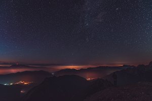 Sunset and stars at dusk in Alps
