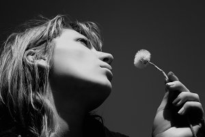 Woman with a dandelion