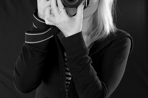 Blond girl taking pictures