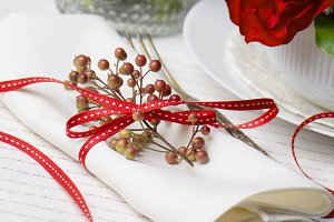 White napkin decorated with red ribb