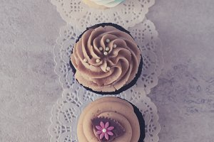 Three Cupcakes on Doilies