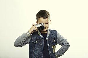 Kid with vintage camera