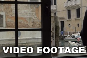 Woman enjoying Venice scene from