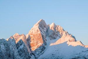 Alpine mountain peak at sunrise