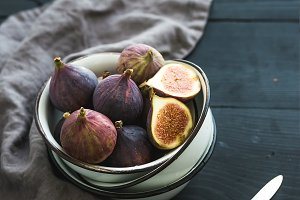 Rustic metal bowl of fresh figs