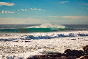 Waves breaking onto rocks