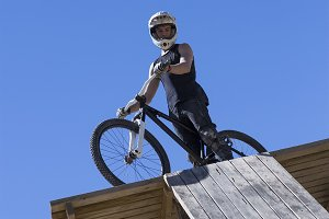 BMX bicycle rider ready to jump