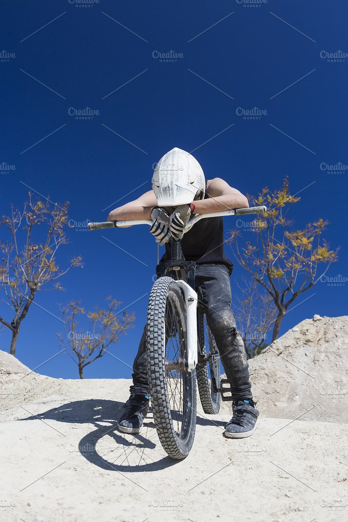 BMX cyclist exhausted.jpg - Sports