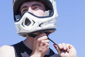 BMX cyclist puts an helmet