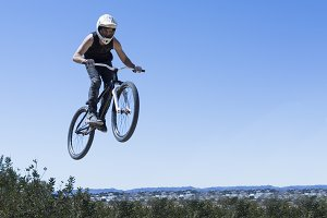 BMX rider jumping with bike