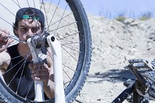 cyclist fixing the BMX bike wheel