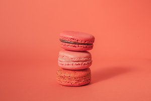 Stack of macaroons in red background