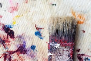 Brush on colorful stained cloth