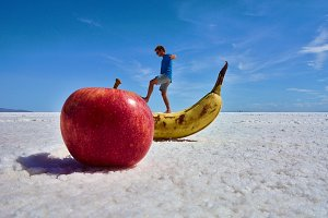 A Boy Stepping on an Apple