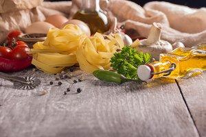 nest pasta with food ingredients