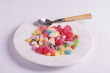 Plate with a spoon full of candies
