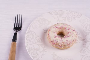 Donut on a plate with a fork