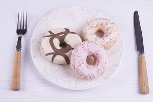 Strawberry and chocolate donuts