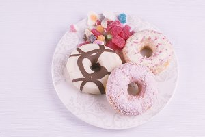 Donuts with candies on a plate