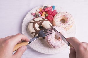 Eating utensils cutting donuts