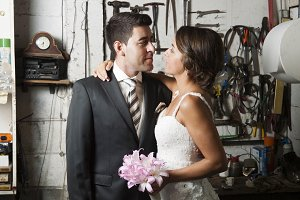 Bride and groom inside a garage