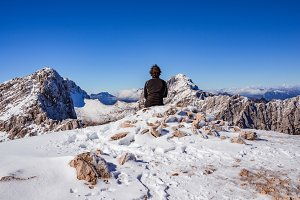 Hiker at top of mountain in winter