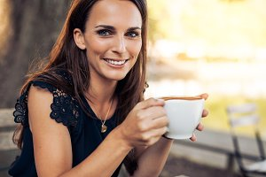Smiling young woman with coffee