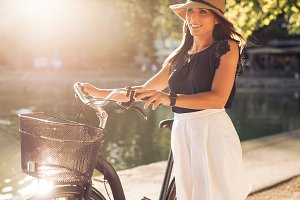 Pretty young woman with a bicycle