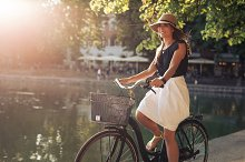 Attractive young woman cycling