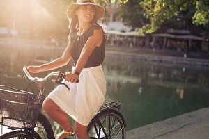 Beautiful young woman riding a bike