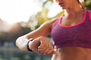 Runner checking her smartwatch