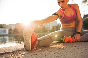 Runner athlete stretching legs