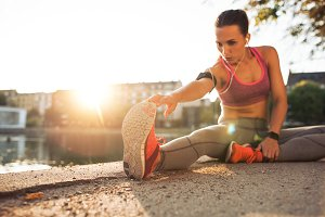 Fitness woman stretching before run
