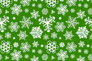 modern snowflakes on green