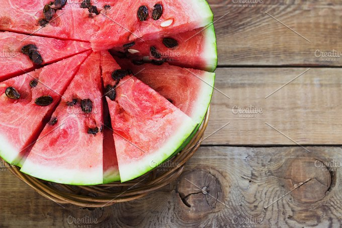 Cut in half watermelon on old wooden table. Red ripe fruit wood background top view image - Food & Drink