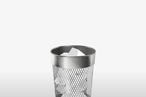 Steel trash can with paper garbage