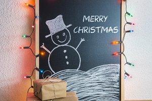 Christmas gifts and chalkboard