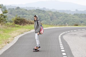 boy on skateboard on the road