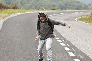 boy on skateboard on the road