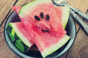 slices of watermelon in a metal bowl