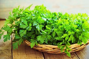 Fresh green parsley on wooden background