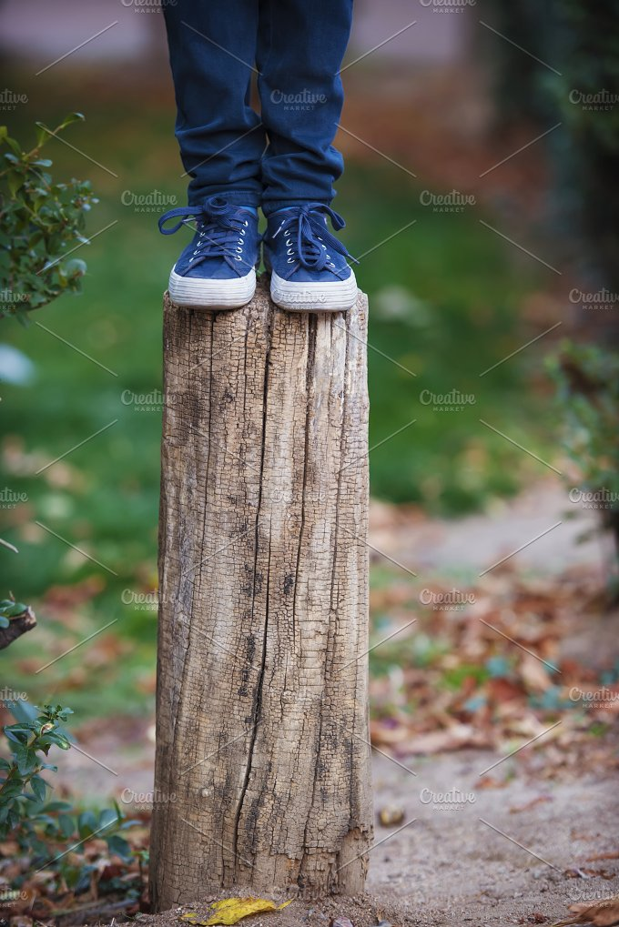 Sneakers and jeans on the stump - People
