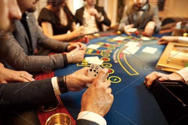 People play poker at the table in featuring poker, casino, and cards |  High-Quality People Images ~ Creative Market