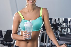 Smiling brunette in the fitness club
