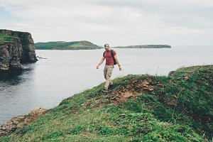 Hiker man walking on coastline