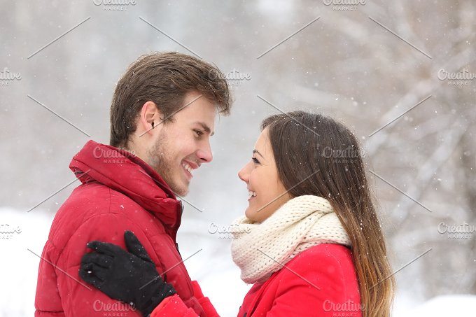 Couple in looking each other in winter.jpg - People