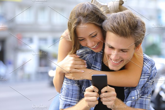 Couple or friends funny with a smart phone.jpg - Technology