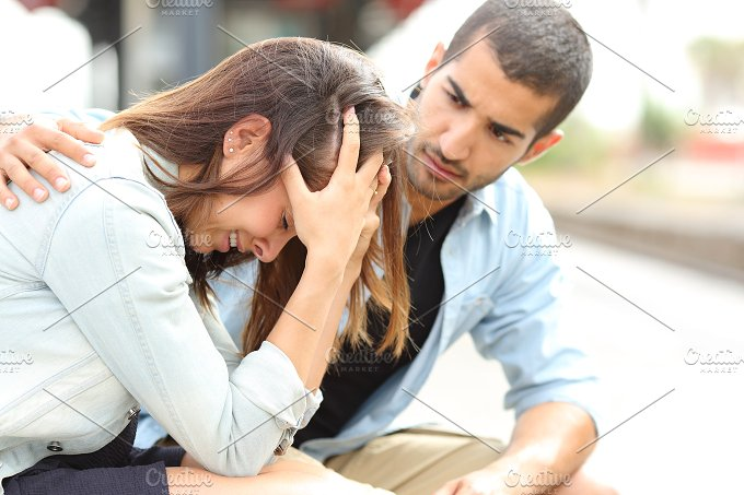 Muslim man comforting a sad girl mourning.jpg - People